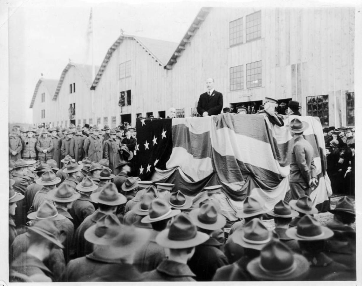 Mayor Percival addresses 8,000 soldiers in front of the recently completed Spruce Production Mill in February 1918. The mill processed the lightweight, flexible wood needed for planes. Of the crowd attending, 2,400 soldiers worked at the mill. The rest came from around the Pacific Northwest. The Spruce Production Division commanded 25,000 soldiers. Three years after his speech before this crowd, well-liked Mayor Percival disappeared, throwing all of Clark County into a tizzy.