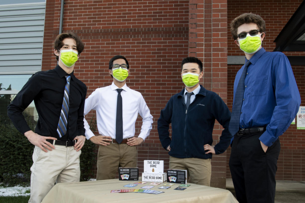 From left, Joshua Helm, Steven Nguyen, Austin Lee and Colton Harris with The Bear Game at Union High School. The four seniors are the creative and marketing force behind The Bear Game family card game.