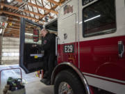 Clark-Cowlitz Fire Rescue Chief John Nohr steps out of a new fire truck Wednesday at Fire Station 26 in Dollars Corner.