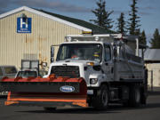 Crews from Clark County Public Works Department are gearing up for the possibility of severe winter weather, as seen Wednesday afternoon, Feb. 10, 2021.