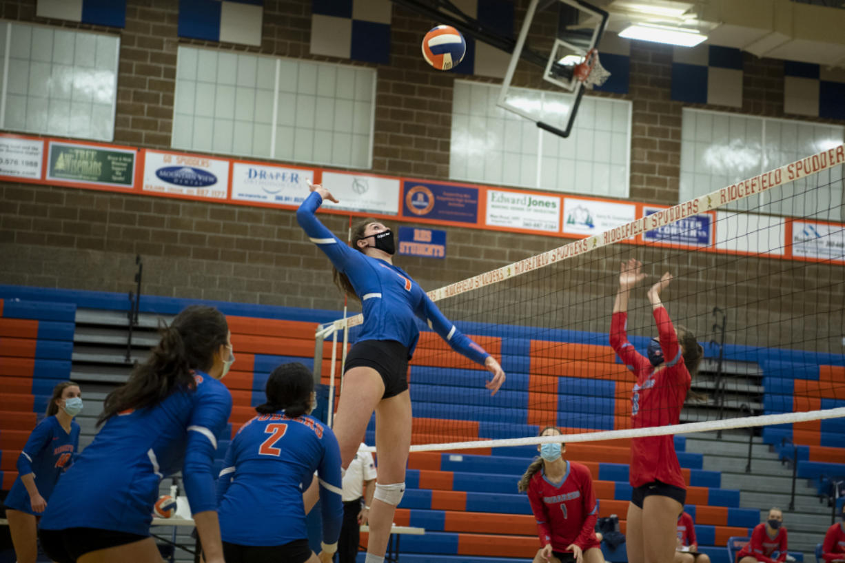 Ridgefield's Ali Andrew rises up for a hit on Tuesday at Ridgefield High School. Ridgefield won 25-20, 25-9, 25-12 over Mark Morris in its first volleyball match since winning the 2A State Championship in fall 2019.