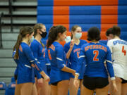 Ridgefield's Presley McCaskill adjusts her mask during a timeout on Tuesday, February 16, 2021, at Ridgefield High School. Ridgefield won 25-20, 25-9, 25-12 over Mark Morris in its first volleyball match since winning the 2A State Championship in fall 2019.
