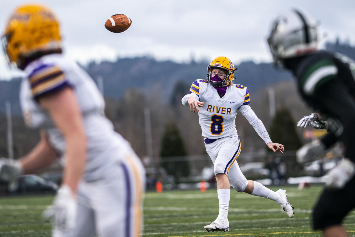 Columbia River's Mason Priddy completes a pass fora. Touchdown against Woodland during a season opener game at Woodland High School on Saturday night, Feb. 20, 2021.