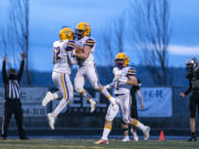 Columbia River celebrates in the end zone before a penalty took back the touchdown during a season opener game at Woodland High School on Saturday night, Feb. 20, 2021.