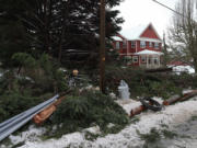 Clark County Public Utilities crews are continuing to work around the clock to restore power to its customers following this weeken's winter weather and ongoing thaw. A spokesman said some roads are still inaccessible due to fallen trees.