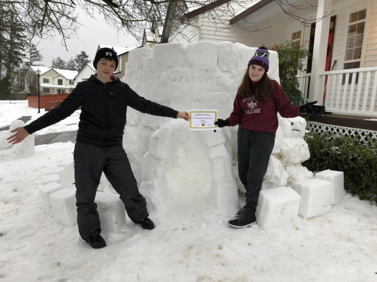 EAST VANCOUVER: Karina and Sullivan May built a big snow fort outside of their home.