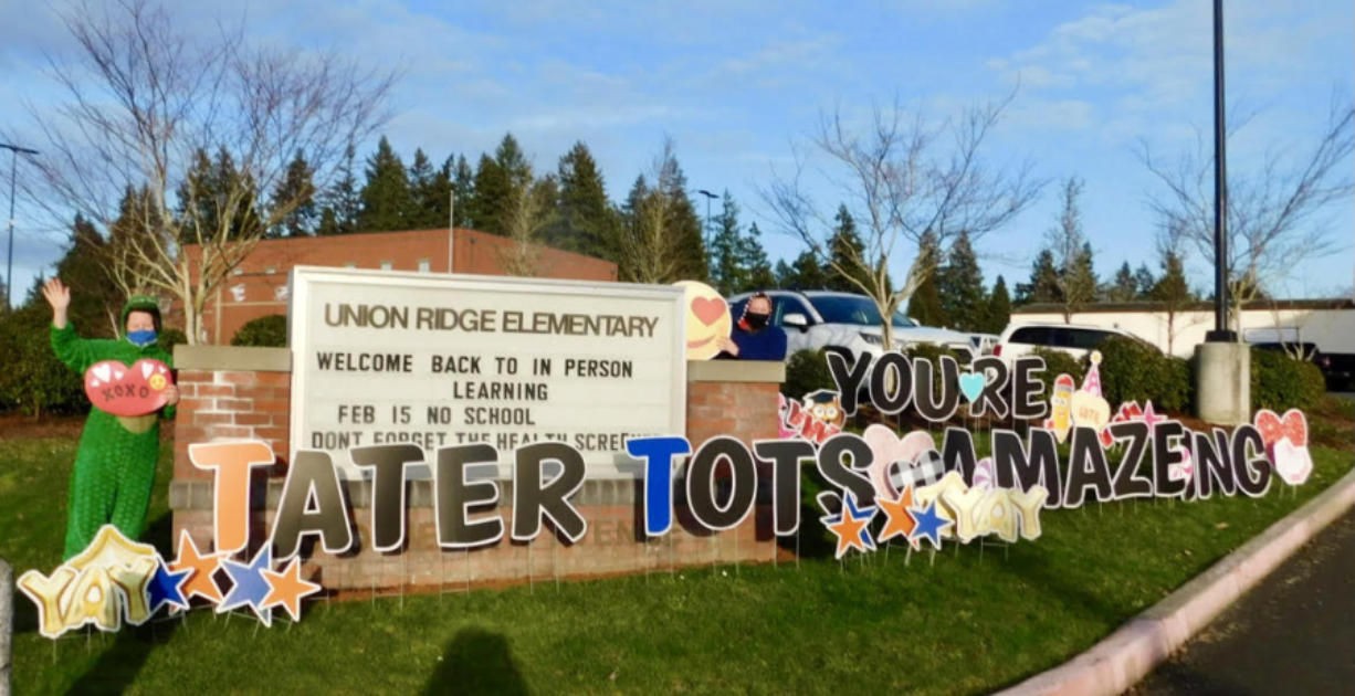 RIDGEFIELD: The entry to the parking lot at Union Ridge Elementary School had a huge sign and teachers in costumes to greet the students for a Valentine's Day drive-thru event.