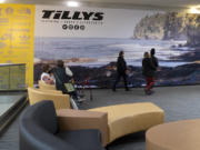 Shoppers rest on recently upgraded seating while others walk by in front the future Tillys storefront at the Vancouver Mall. The casual apparel retailer is set to open in the second quarter of this year, and another big-name clothing chain, Windsor, will debut in the third quarter.