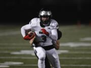 Union wide receiver Jake Bowen runs after a reception against Camas. Union vs. Camas on February 26, 2021.