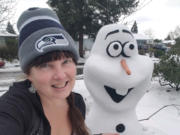 """ORCHARDS: Laura Mathews constructed popular """"Frozen"""" movie character Olaf in the yard of her Orchards home after a snow storm hit the region earlier this month."""