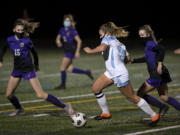 Hockinson junior Payton Lawson weaves her way through the Columbia River defense on Saturday, February 27, 2021, at Columbia River High School. The Hawks earned a 1-0 victory over Columbia River in a rematch of the 2019 2A State girls soccer championship.