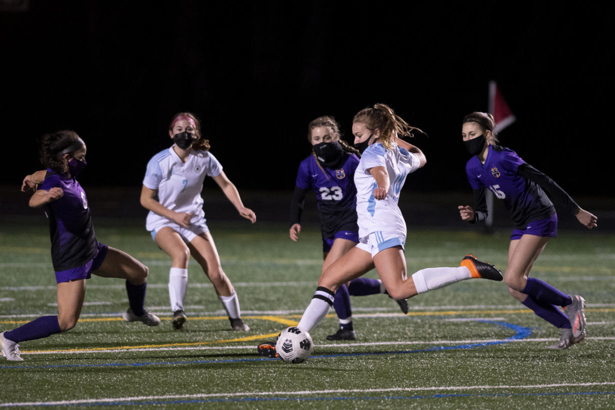 Hockinson's Payton Lawson fires a shot on Saturday, February 27, 2021, at Columbia River High School. The Hawks earned a 1-0 victory over Columbia River in a rematch of the 2019 2A State girls soccer championship.
