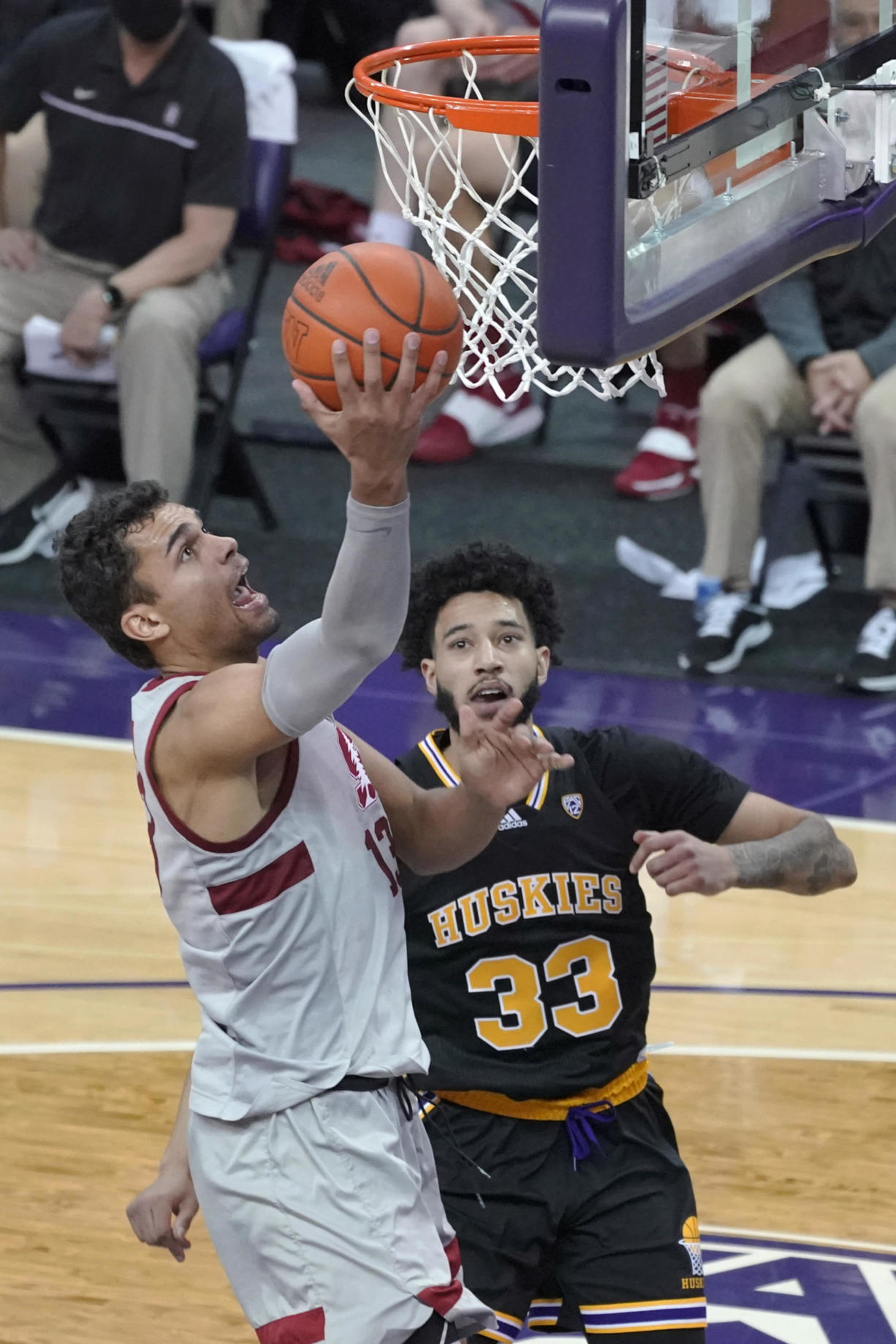 Stanford forward Oscar da Silva, left, shoots against Washington forward J'Raan Brooks (33) during the second half of an NCAA college basketball game Thursday, Feb. 18, 2021, in Seattle. (AP Photo/Ted S.
