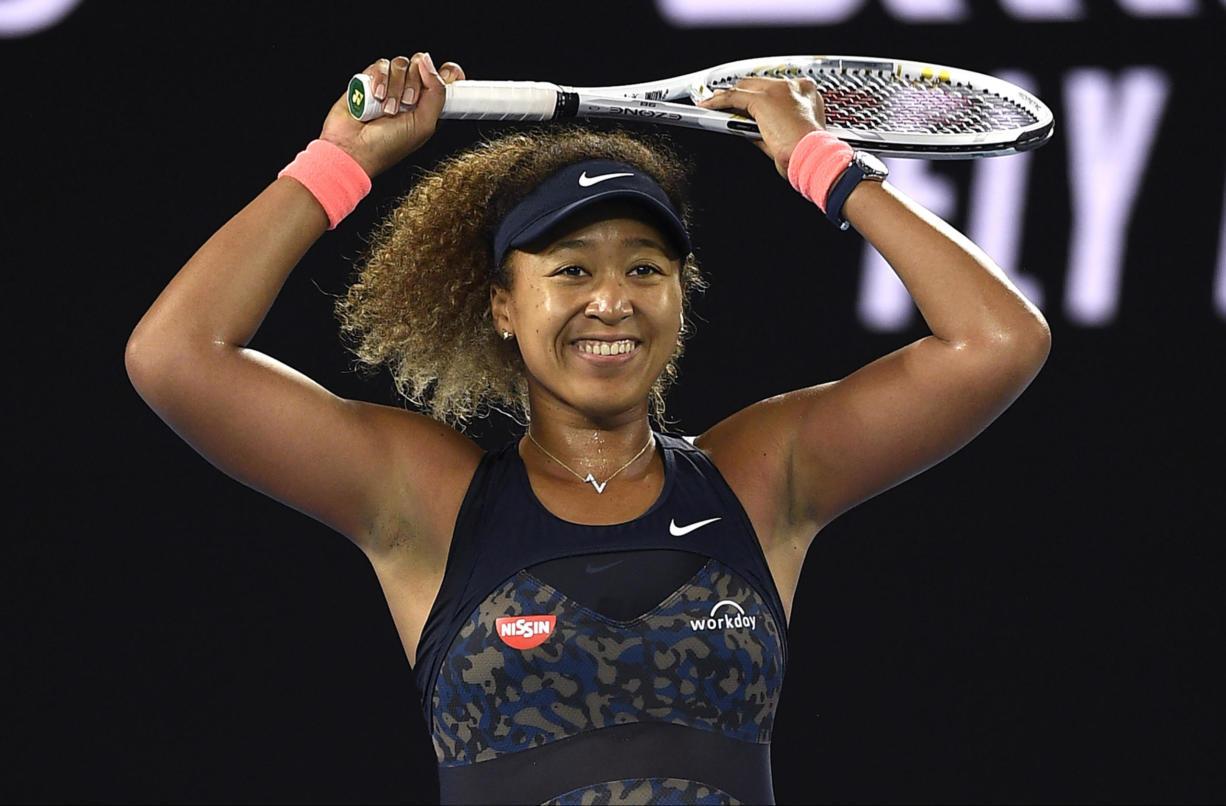 Japan's Naomi Osaka celebrates after defeating United States' Jennifer Brady during the women's singles final at the Australian Open tennis championship in Melbourne, Australia, Saturday, Feb.