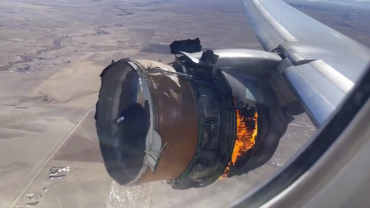 """In this image taken from video, the engine of United Airlines Flight 328 is on fire after after experiencing """"a right-engine failure"""" shortly after takeoff from Denver International Airport, Saturday, Feb. 20, 2021, in Denver, Colo. The flight landed safely and none of the passengers or crew onboard were hurt."""
