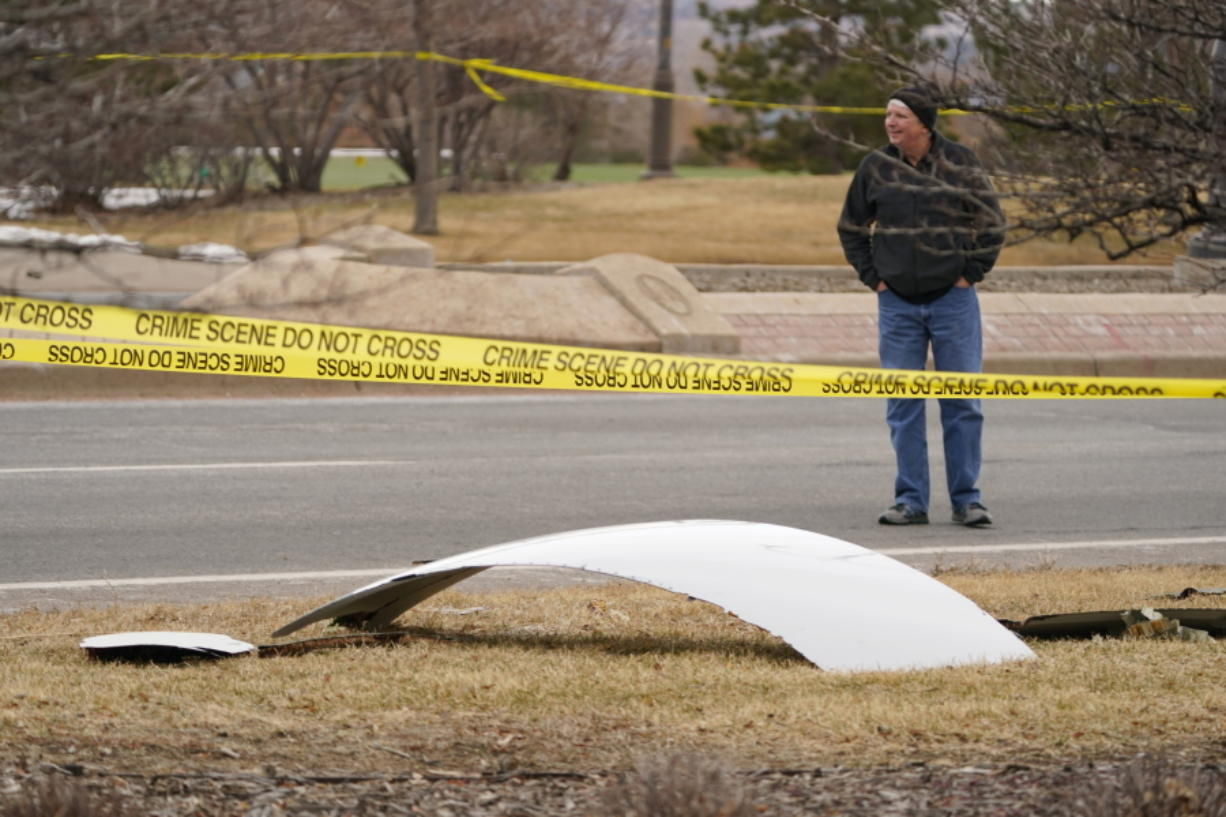 A piece of debris from a commercial airplane is surrounded by police tape on a strip along Midway Boulevard in Broomfield, Colo., after the plane shed parts while making an emergency landing at nearby Denver International Airport Saturday, Feb. 20, 2021.