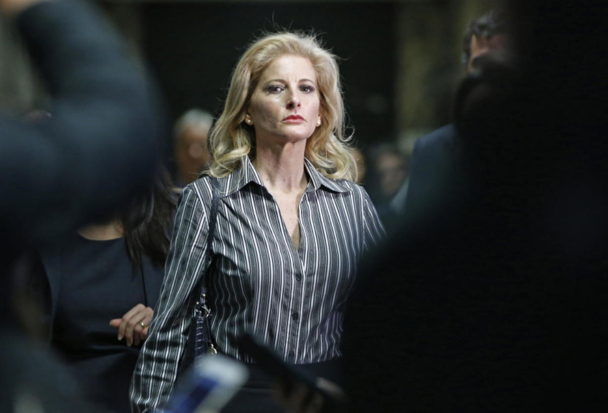 "FILE - In this Dec. 5, 2017, file photo, Summer Zervos leaves Manhattan Supreme Court at the conclusion of a hearing in New York. The former ""Apprentice"" contestant is trying to get her defamation lawsuit against former President Donald Trump moving again now that he's no longer president."