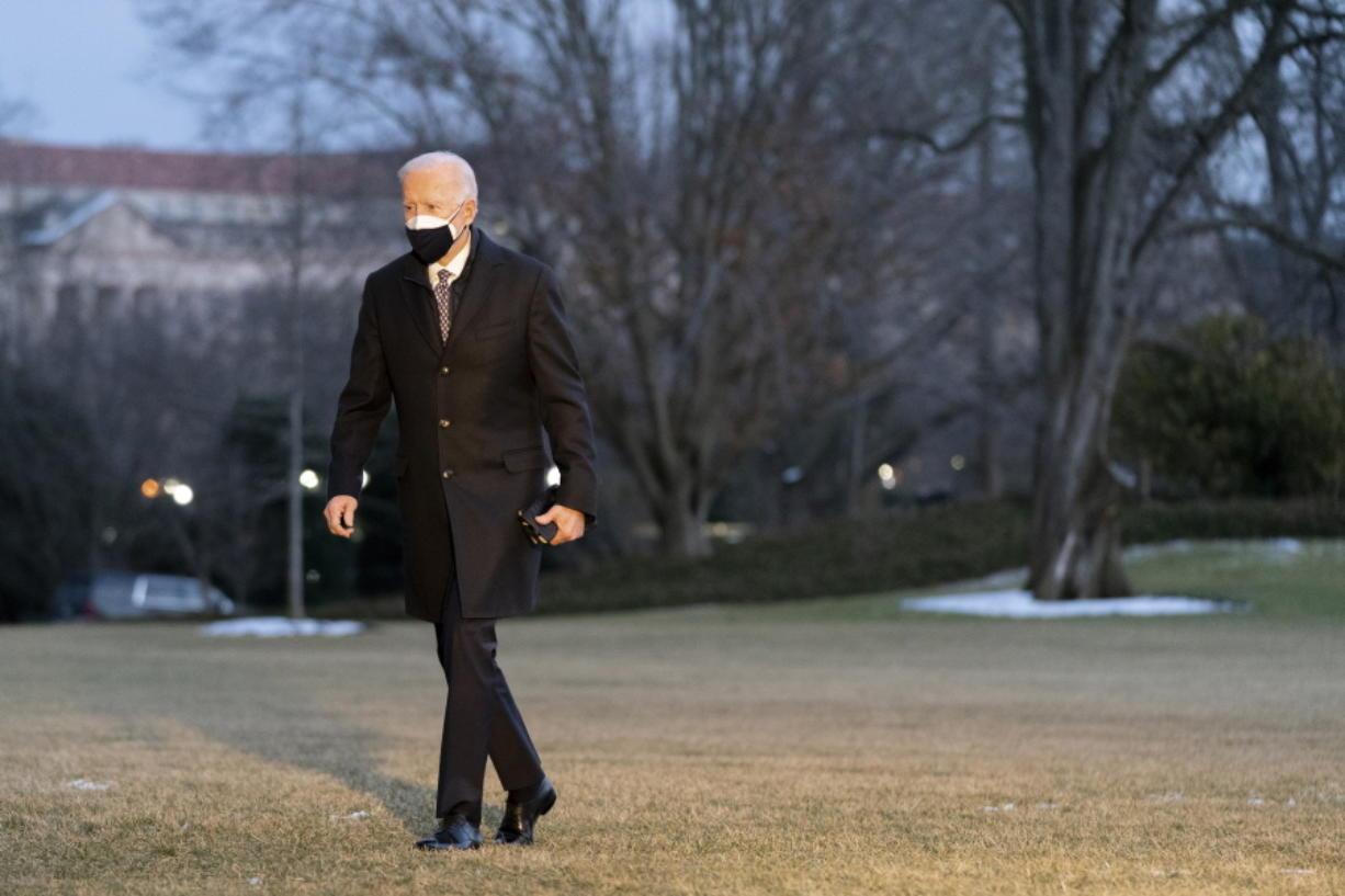 President Joe Biden walks on the South Lawn of the White House after stepping off Marine One, Friday, Feb. 19, 2021, in Washington. Biden is returning to Washington after visiting Pfizer's COVID-19 vaccine manufacturing site near Kalamazoo, Mich.