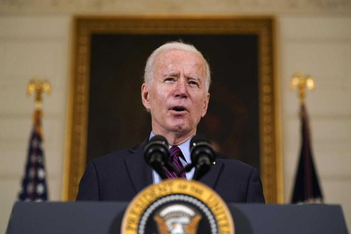 FILE - In this Friday, Feb. 5, 2021, file photo, President Joe Biden speaks in the State Dining Room of the White House, in Washington.