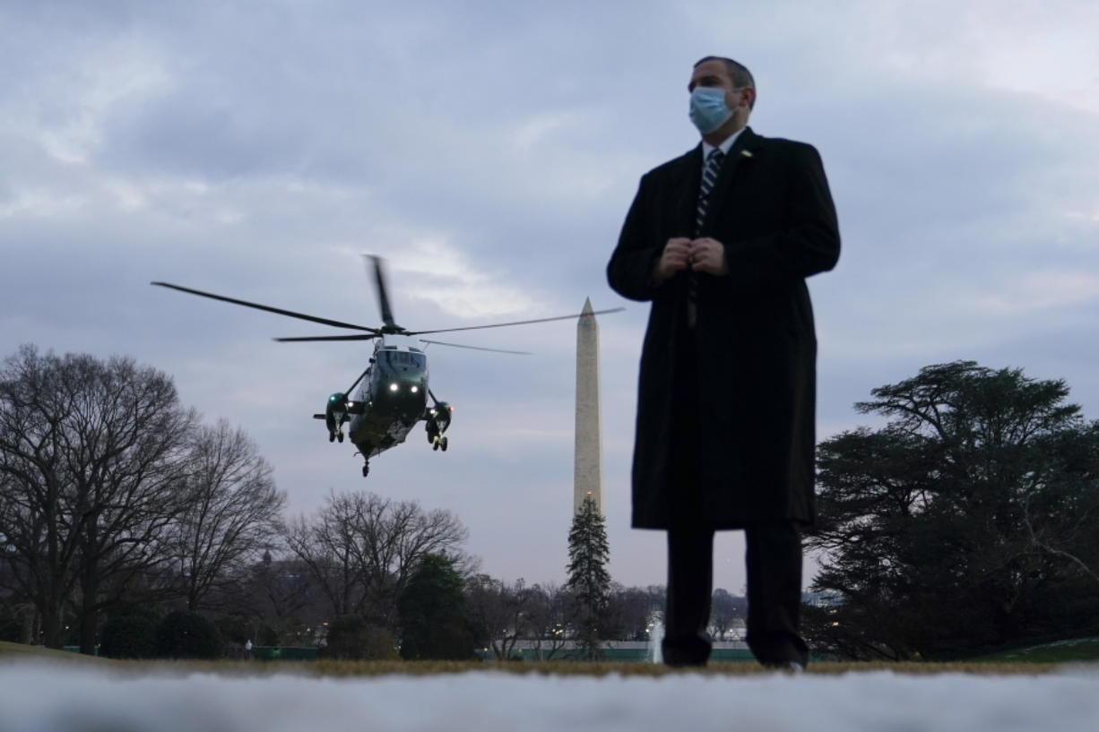 Marine One, with President Joe Biden aboard, approaches the South Lawn of the White House, Friday, Feb. 19, 2021, in Washington. Biden is returning to Washington after visiting Pfizer's COVID-19 vaccine manufacturing site near Kalamazoo, Mich.