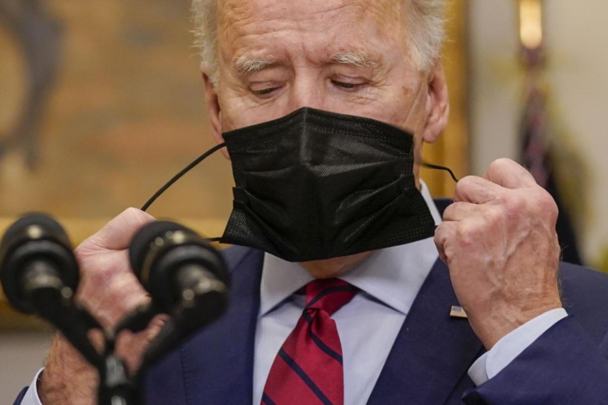 President Joe Biden removes his mask before speaking on the economy in the Roosevelt Room of the White House, Saturday, Feb. 27, 2021, in Washington. (AP Photo/Pablo Martinez Monsivais) (J.