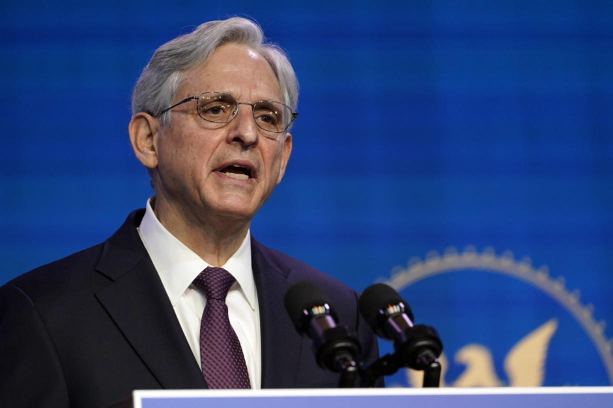 FILE - In this Jan. 7, 2021, file photo Attorney General nominee Judge Merrick Garland speaks during an event with President-elect Joe Biden and Vice President-elect Kamala Harris at The Queen theater in Wilmington, Del. The once-snubbed Supreme Court pick will finally come before the Senate, this time as President Joe Biden's choice for attorney general. Garland, an appeals court judge, is widely expected to sail through his confirmation process, beginning Monday at a hearing, with bipartisan support.