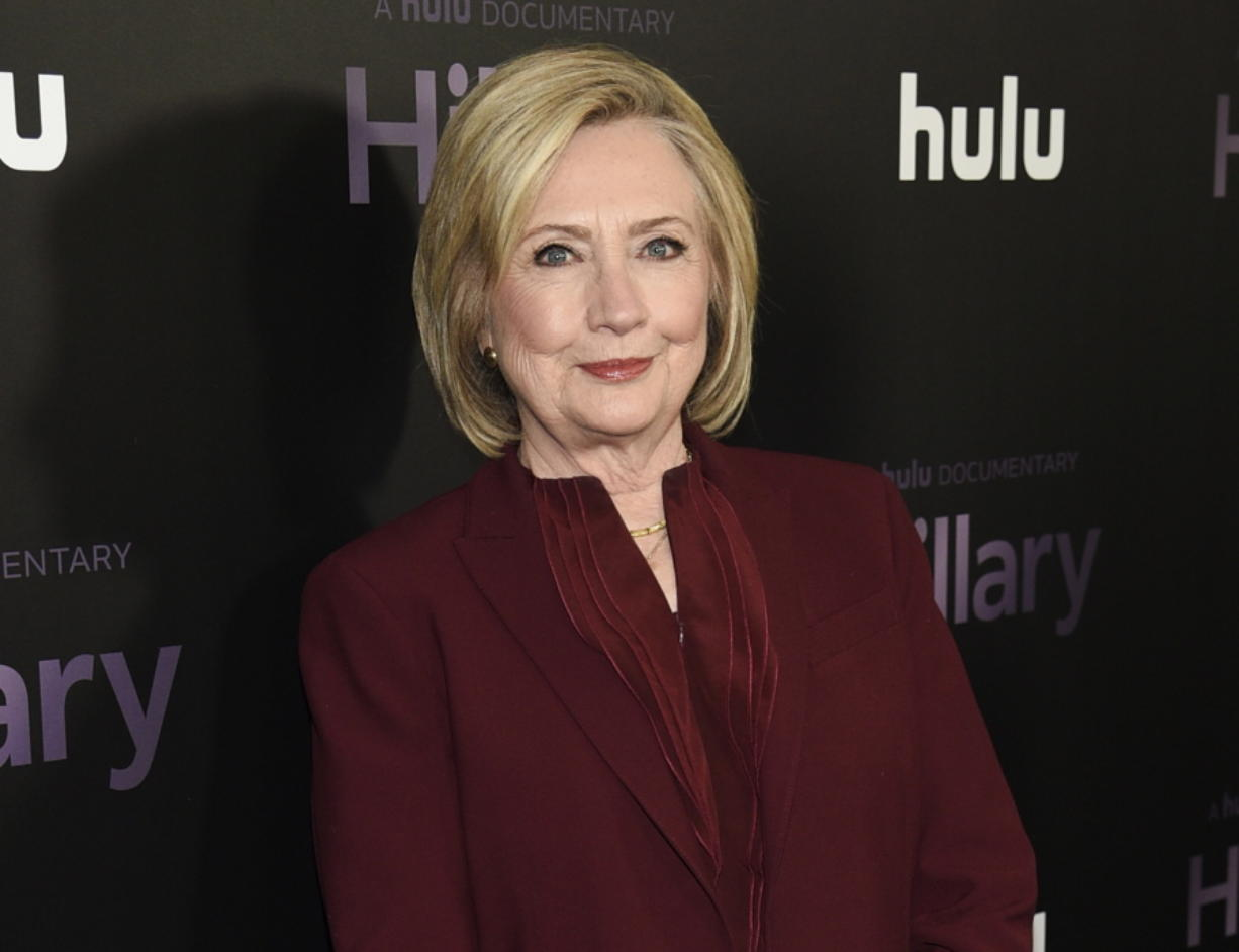 """FILE - Former secretary of state Hillary Clinton attends the premiere of the Hulu documentary """"Hillary"""" in New York on March 4, 2020. Clinton is teaming up with her friend Louise Penny on the novel """"State of Terror,"""" out Oct. 12, 2021."""