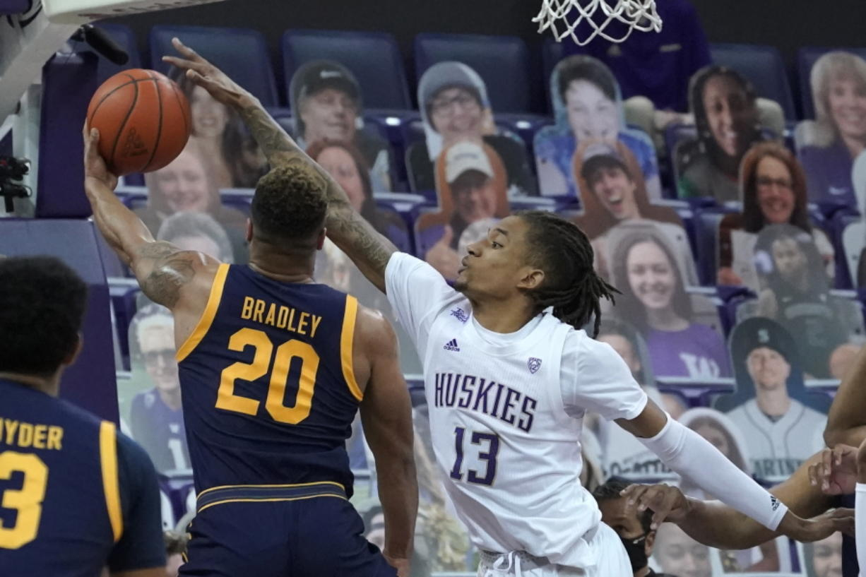 Washington forward Hameir Wright (13) blocks a shot by California guard Matt Bradley (20) during the first half of an NCAA college basketball game Saturday, Feb. 20, 2021, in Seattle. (AP Photo/Ted S.