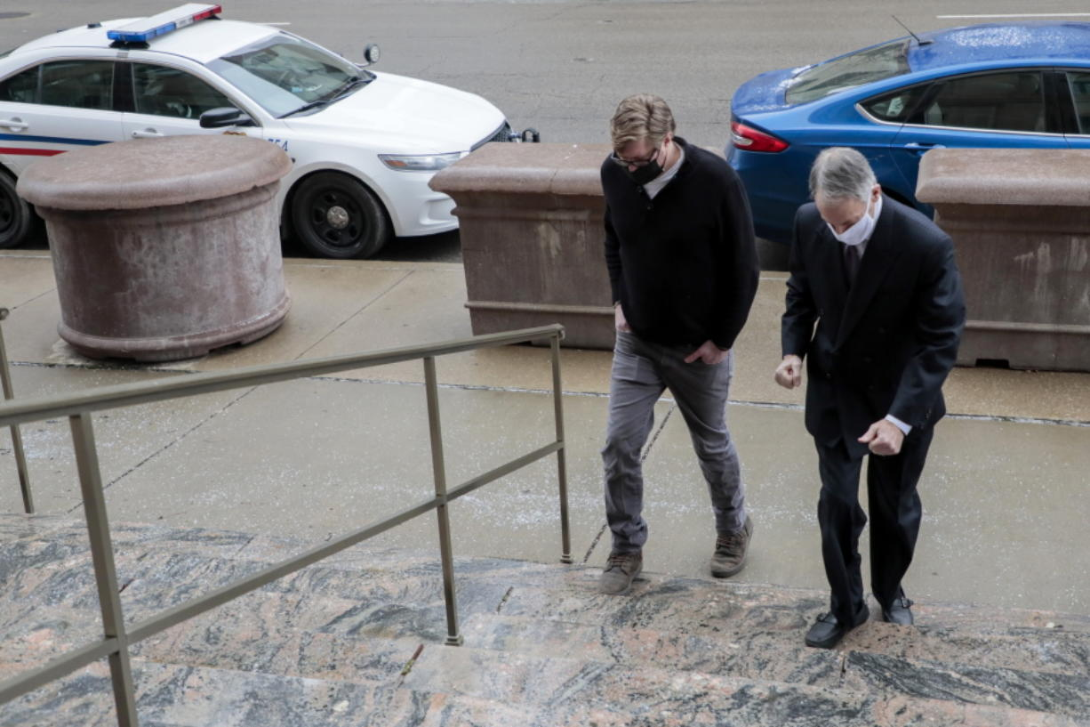 Dustin Thompson, left, of Columbus, who is accused of being part of the Jan. 6 insurrection at the U.S. Capitol, arrives with his lawyer, Sam Shamansky, to turn himself in on Monday, Jan. 25, 2021, at the Joseph P. Kinneary U.S. District Courthouse in Columbus, Ohio. (Joshua A.