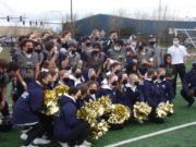 The Seton Catholic football team and cheerleaders celebrate the team's 28-26 overtime win over Columbia-White Salmon (Tim Martinez/The Columbian)