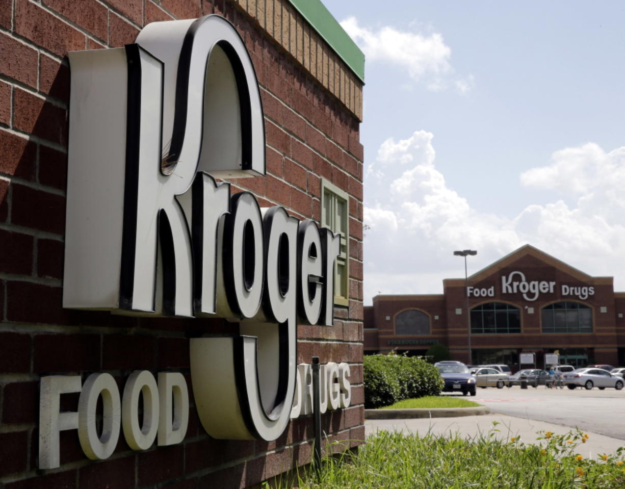 FILE - This June 17, 2014, file photo, shows a Kroger store in Houston. Kroger Co. says it was among the multiple victims of a data breach involving a third-party vendor's file-transfer service and is notifying potentially impacted customers, offering them free credit monitoring. The Cincinnati-based grocery and pharmacy chain said in a statement Friday, Feb. 19, 2021, that it believes less than 1% of its customers were affected, specifically some using its Health and Money Services, as well as some current and former employees because a number of personnel records were apparently viewed. (AP Photo/David J.