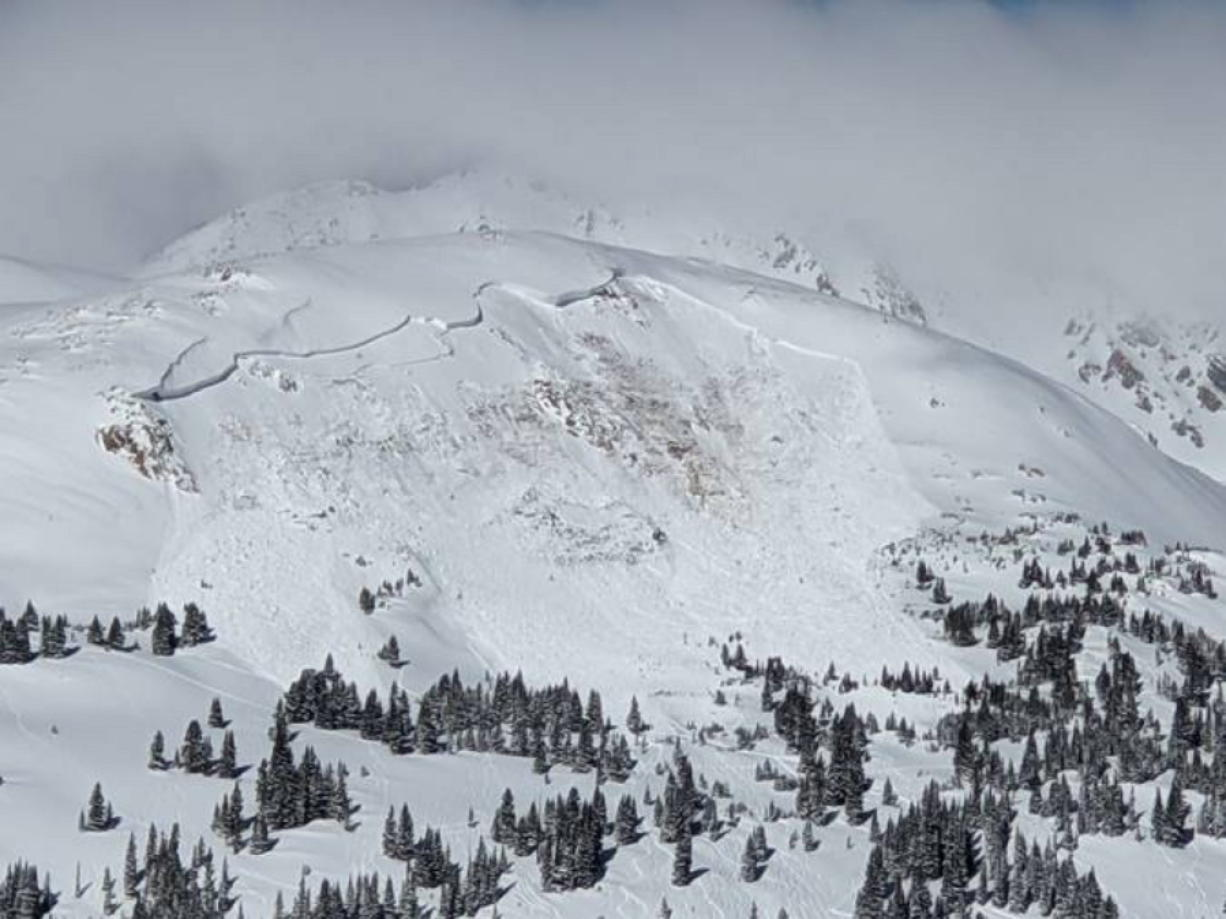 An avalanche that killed an unidentified snowboarder is seen Feb. 14 near the town of Winter Park, Colorado.