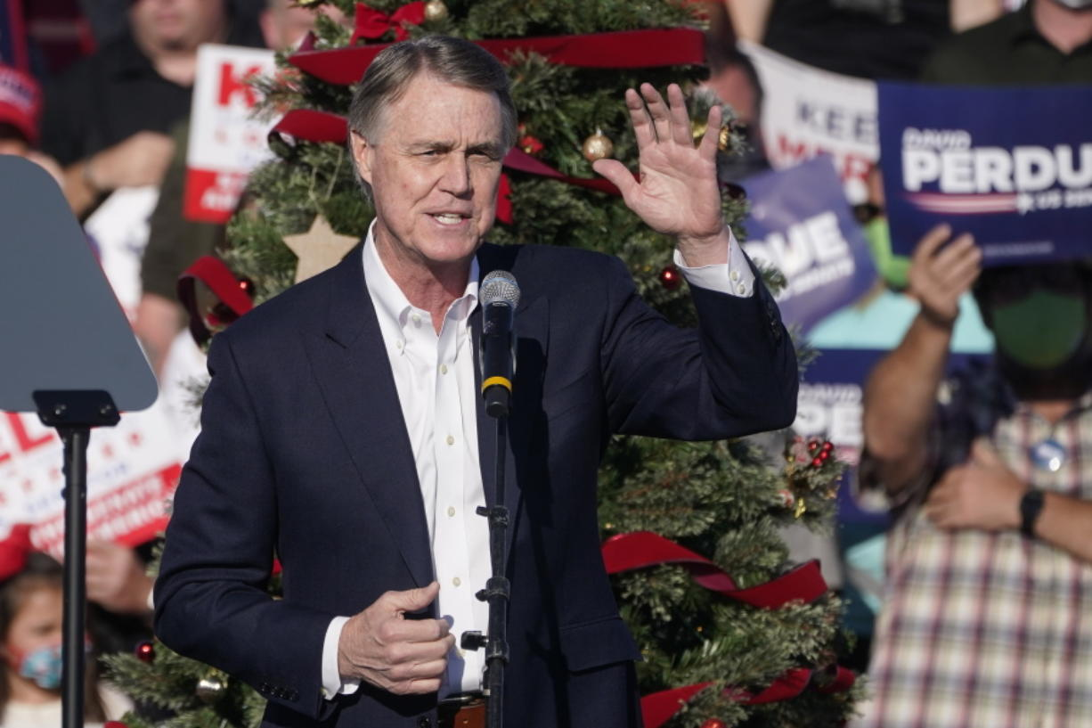 """FILE - In this Dec. 10, 2020 file photo, Sen. David Perdue, R-Ga., speaks during a """"Save the Majority"""" rally in Augusta, Ga.  Perdue says he won't run in 2022 to reclaim a seat in the U.S. Senate. The announcement came Tuesday, Feb. 23, 2021, eight days after the defeated Republican filed campaign paperwork that could have opened the way for him to run against Democratic Sen."""