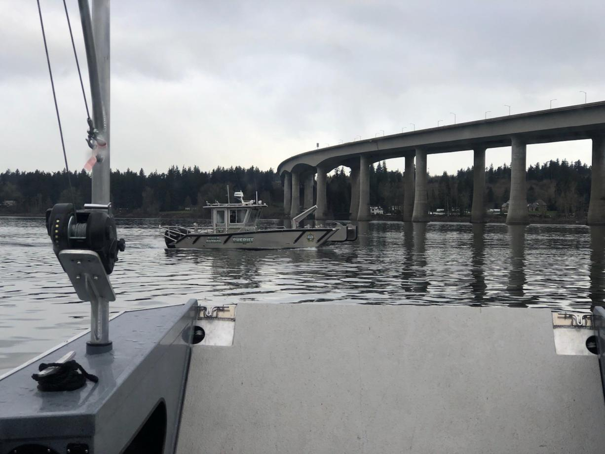 The Multnomah County Sheriff's Office searches the Columbia River near the Interstate 205 bridge for a vehicle that may have gone in the water on Sunday.