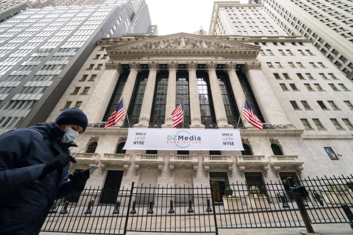 FILE - Pedestrians pass the New York Stock Exchange, Wednesday, Jan. 27, 2021, in New York.  Stocks are opening higher on Wall Street following three straight days of losses. The S&P 500 rose 0.2% in the first few minutes of trading Friday, Feb. 19.