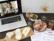 """This image released by Murray's Cheese shows a display of cheeses in front of a laptop showing a virtual class about cheese. In this pandemic climate, there are lots of ways to make this Valentine's Day feel special without putting your health at risk or spending a lot of cash. Murray's Cheese has expanded their selection of virtual classes, which include one on making cheese boards, and one on creating a """"Most Decadent Valentine's Day."""" All the classes can be taken live or bought to view later."""