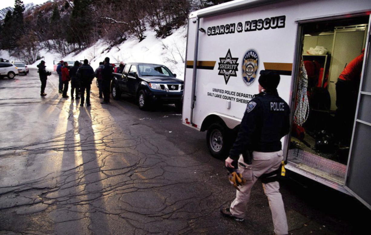 Salt Lake County Sheriff Search and Rescue crews respond to the top of Millcreek Canyon where four skiers died in an avalanche Saturday, Feb. 6, 2021, near Salt Lake City. Four other skiers were injured, authorities said. The Unified Police Department told local media that it was alerted to the avalanche about 11:40 a.m. after receiving a faint distress call from an avalanche beacon in the canyon. The skier-triggered avalanche swept up eight people in their early twenties to late thirties who were in two groups touring the backcountry, Unified Police Sgt. Melody Cutler told the Salt Lake Tribune.