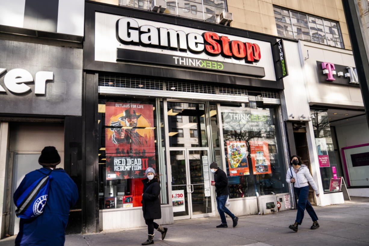 FILE - Pedestrians pass a GameStop store on 14th Street at Union Square, Thursday, Jan. 28, 2021, in the Manhattan borough of New York.  The GameStop saga has been portrayed as a victory of the little guy over Wall Street giants but not everyone agrees, including some lawmakers in Washington.  The House Financial Services Committee is ready to dig into the confounding episode at a hearing on Thursday, Feb. 18.