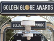 FILE - Event signage appears above the red carpet at the 77th annual Golden Globe Awards, on Jan. 5, 2020, in Beverly Hills, Calif. The 78th annual Golden Globes will be held on Sunday, Feb. 18, 2021.