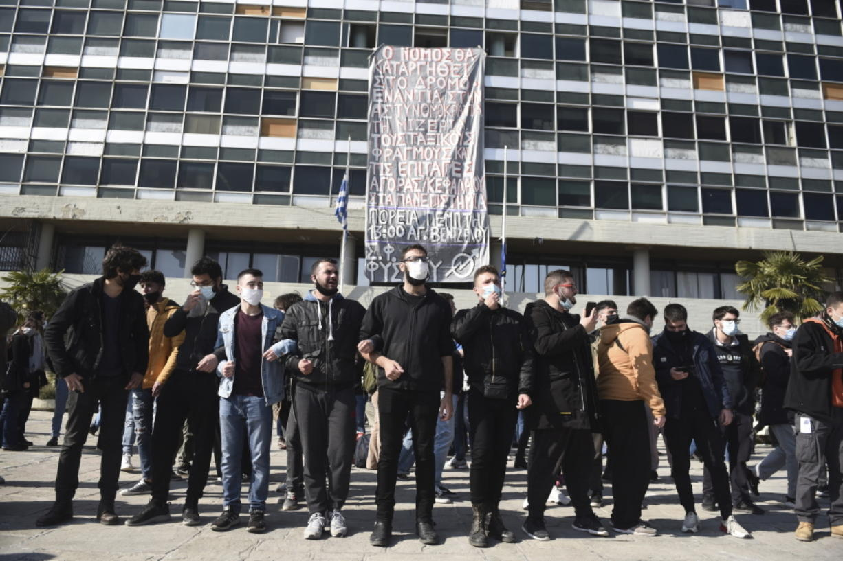 Protesters chant slogans at the University of Thessaloniki in northern Greece, on Monday, Feb. 22, 2021. Police clashed with protesters and detained more than 30 people in Greece's second-largest city Monday during a demonstration against a new campus security law.
