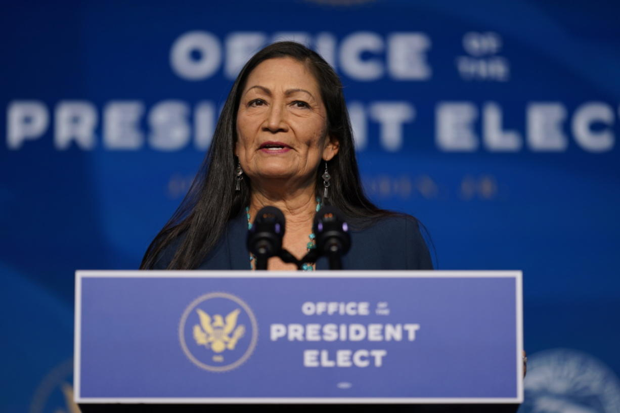 FILE - In this Dec. 20, 2020, file photo the Biden administration's nominee for Secretary of Interior, Rep. Deb Haaland, D-N.M., speaks at The Queen Theater in Wilmington Del. Haaland has stood with fellow tribal members in protesting an oil pipeline, advocating for protecting cultural landmarks and criticizing destruction of Native American sites near the U.S.-Mexico border. Native Americans have reason to believe the two-term U.S. congresswoman will push forward on long-simmering issues in Indian Country if she's confirmed as secretary of the Interior Department.