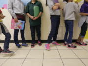"""FILE - In this Aug. 29, 2019, file photo, migrant teens line up for a class at a """"tender-age"""" facility for babies, children and teens, in Texas' Rio Grande Valley, in San Benito, Texas. With its long-term facilities for immigrant children nearly full, the Biden administration is working to expedite the release of children to their relatives in the U.S. The U.S. Health and Human Services on Wednesday, Feb. 24, 2021, authorized operators of long-term facilities to pay for some of the children's flights and transportation to the homes of their sponsors."""