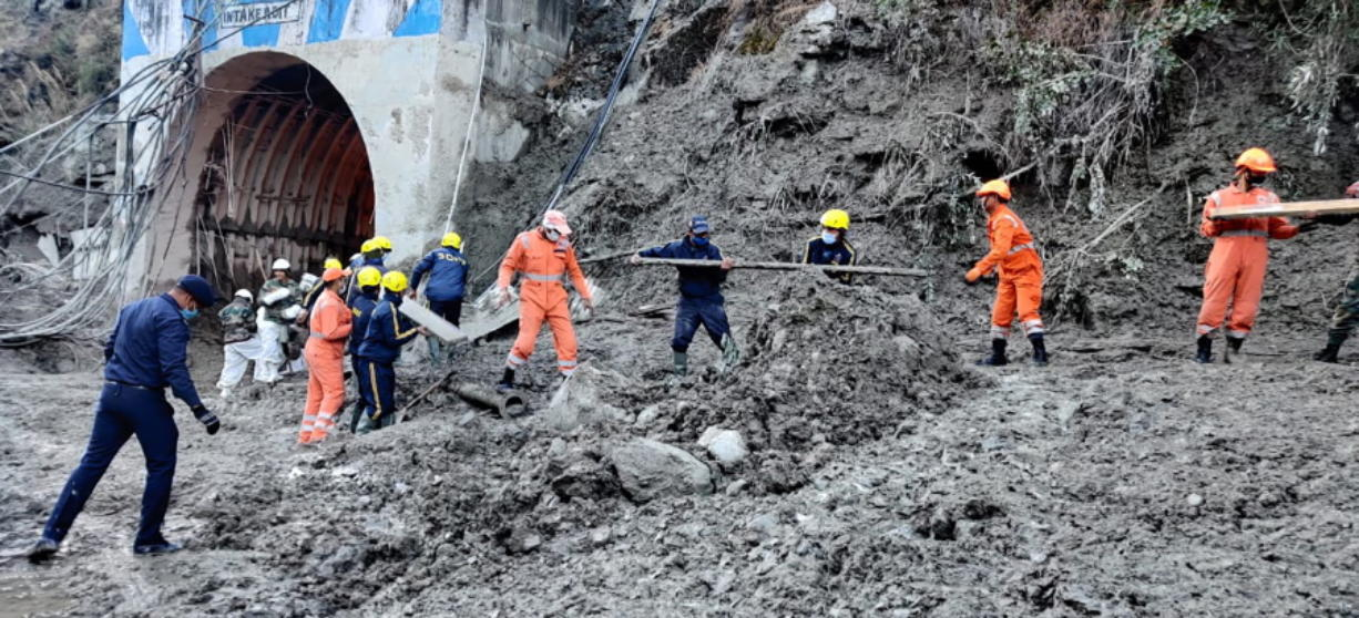 This photograph provided by National Disaster Response Force shows NDRF personnel prepare to rescue workers at one of the hydropower project at Reni village in Chamoli district of Indian state of Uttrakhund, Monday, Feb. 8, 2021. Rescue efforts continued on Monday to save 37 people after part of a glacier broke off, releasing a torrent of water and debris that slammed into two hydroelectric plants on Sunday.
