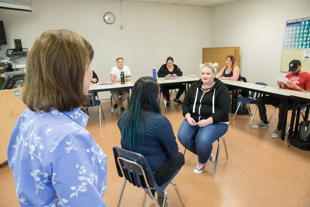 Clark College students enrolled in the Bachelor of Applied Science in Human Services program practice counseling techniques in the classroom while Professor Marcia Roi, bottom left, observes and provides guidance.