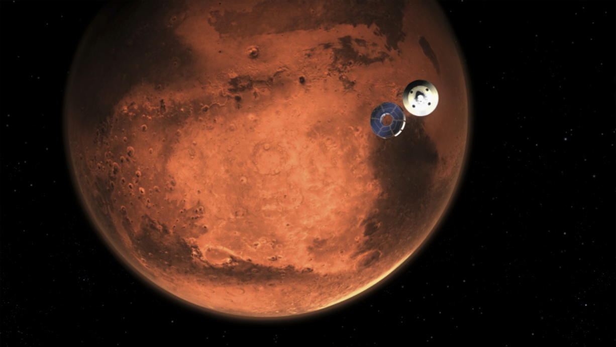 In this illustration made available by NASA, the Perseverance rover casts off its spacecraft's cruise stage, minutes before entering the Martian atmosphere.