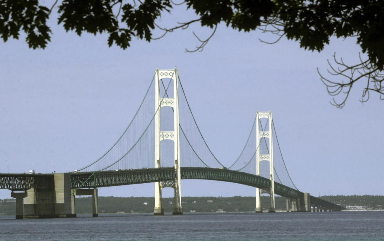 FILE - This July 19, 2002, file photo, shows the Mackinac Bridge that spans the Straits of Mackinac from Mackinaw City, Mich. Michigan's environmental agency said Friday, Jan. 29, 2021, it had approved construction of an underground tunnel to house a replacement for a controversial oil pipeline in a channel linking two of the Great Lakes.