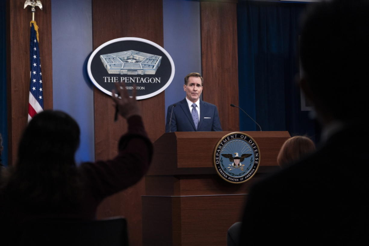 """FILE - In this Feb. 17, 2021, file photo, Pentagon spokesman John Kirby speaks during a media briefing at the Pentagon in Washington. A U.S. airstrike targeting facilities used by Iran-backed militias in Syria appears to be a message to Tehran delivered by a new American administration still figuring out its approach to the Middle East. Kirby said the operation in Boukamal, Syria, sends an unambiguous message: """"President Biden will act to protect American and coalition personnel."""
