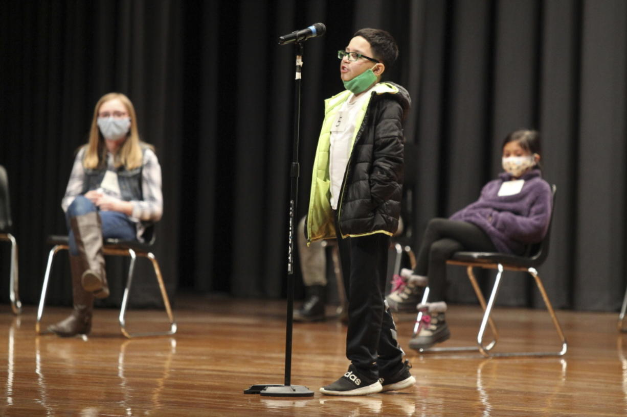Giovanni Flores, a student at Rankin Elementary School, competes in the Tupelo Public School Disctict and Lee County Spelling Bee on Thursday, Jan. 14, 2021, at the Civic Auditorium of Tupelo Middle School in Tupelo, Miss. Mason Cordell, a seventh grader at Tupelo Middle School was this year's winner.