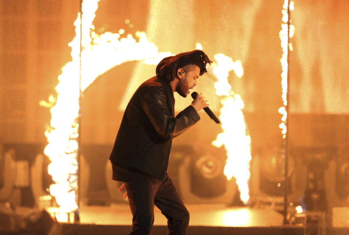 """FILE - In this Sunday, Nov. 22, 2015, file photo, the Weeknd performs at the American Music Awards at the Microsoft Theater in Los Angeles. The Weeknd had the No. 1 song of 2020 but """"Blinding Lights"""" was not nominated for a Grammy Award."""