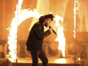 "FILE - In this Sunday, Nov. 22, 2015, file photo, the Weeknd performs at the American Music Awards at the Microsoft Theater in Los Angeles. The Weeknd had the No. 1 song of 2020 but ""Blinding Lights"" was not nominated for a Grammy Award."